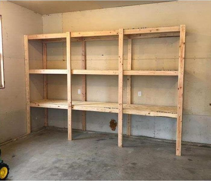 New shelving built in the unused garage space.